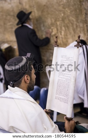 JERUSALEM - JULY 29 : Jewish men prays in the Wailing wall during the Jewish holyday of Tisha B'av , on July 29 2012 in old Jerusalem , Israel