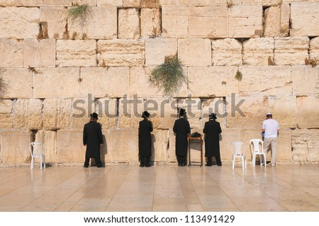 JERUSALEM -July 27 : Jews prays at the Western Wall July 27 , 2012 in Jerusalem, Israel. - stock photo