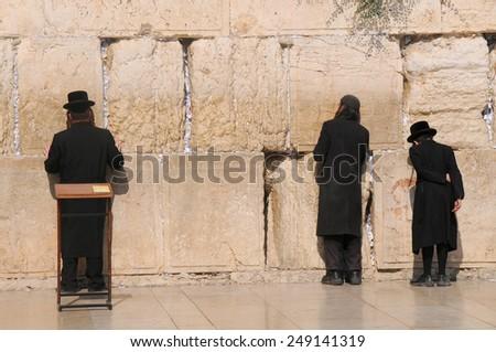JERUSALEM -July 27 : Jews prays at the Western Wall July 27 , 2012 in Jerusalem, Israel. - stock photo