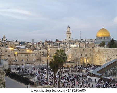 JERUSALEM - MARCH 30: Passover Holiday. People are going to Western Wall for praying, at the same time Muslims are praying on Dome of Rock. March 30, 2013 in Jerusalem, Israel.