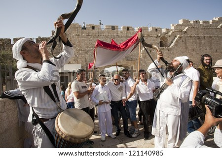 JERUSALEM - MAY 24:  A young teenager celebrates during his Bar Mitzvah ceremony at the Wailing Wall in the Old City of Jerusalem on May 24, 2012 in Jerusalem.