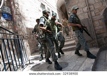 JERUSALEM - MAY 30: Israeli soldiers armed with M16 automatic rifles patrol the Old City of Jerusalem on May 30, 2009