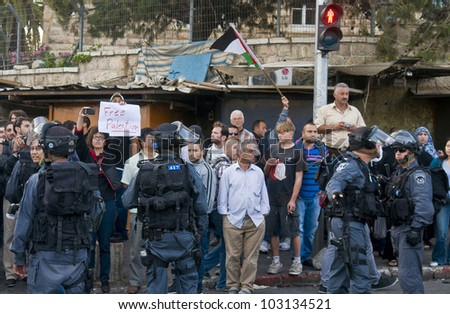 JERUSALEM - MAY 20 : Pro Palestinian activists demonstrating against tens of thousand Israeli right wingers commemorating Jerusalem day with a march to Jerusalem old city on May 20 2012