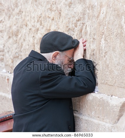 JERUSALEM - MAY 10 : The wailing Wall is a main religious symbol of Israel. Jews, like this unidentified man, pray at the wailing wall on the threshold of the holiday Lag ba-Omer on May 10, 2009 in Jerusalem, Israel. - stock photo