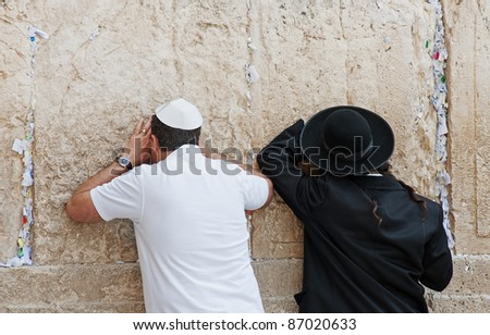 JERUSALEM - MAY 10 : The wailing Wall main religious symbol of Israel. Two jews praying at the wailing wall in the threshold of the holiday Lag ba-Omer on May 10, 2009 in Jerusalem. - stock photo