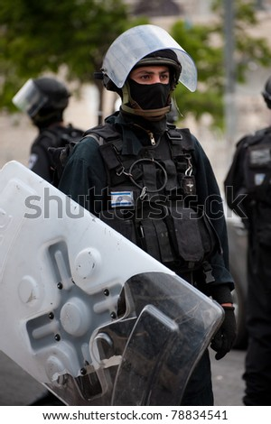 JERUSALEM - MAY 15: Unidentified Israeli riot police patrol streets on the Mount of Olives in East Jerusalem following clashes on Nakba Day on May 15, 2011 in Jerusalem, Israel.