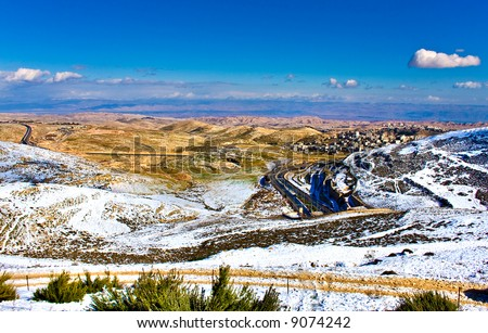 Jerusalem mountains covered with rare snow (with view to the dead sea and Jordan mountains) - stock photo
