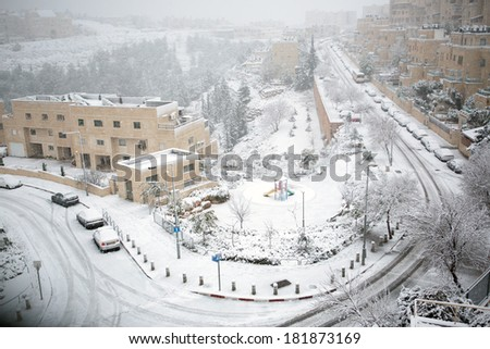 Jerusalem neighborhood and forest after a snow storm  - stock photo