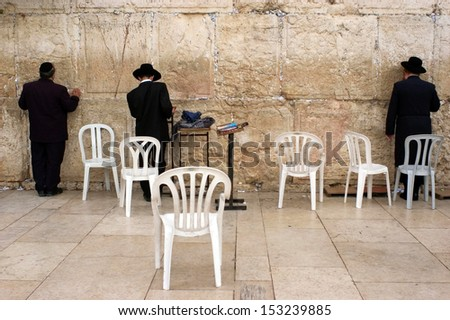 JERUSALEM - OCT 08 :Jewish men pray at the Western Wall during the High Holy Days on Oct 08 2005.During the 10 days before Yom Kippur Holiday Jewish people practice Teshuvah - engaging in repentance. - stock photo