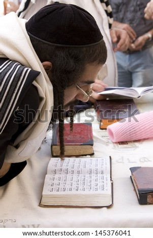 JERUSALEM-OCT 02: The Jew in prayer at the Western Wall during Jewish holiday of Sukkot, October 2, 2012 in Jerusalem,   - stock photo