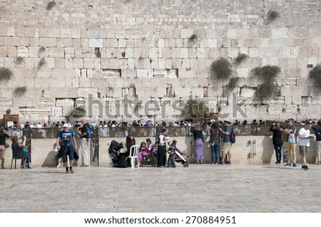 JERUSALEM-OCT 15: The Jews at the Western Wall during Jewish holiday of Sukkot, October 15, 2014 in Jerusalem, Israel.Etrog and Lulav is two of four species used during of Sukkot.  - stock photo