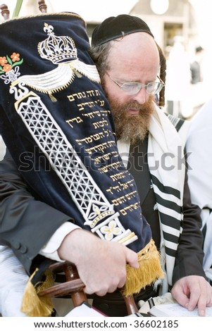 JERUSALEM - OCTOBER 16: Jews in prayer at the Western Wall during Jewish holiday of Sukkot October 16, 2008 in Jerusalem, Israel. Sukkot is one of the Jews three major holidays. - stock photo