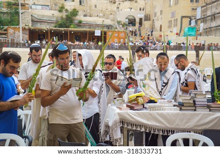 JERUSALEM - OCTOBER 14, 2014: Religious Jews sunrise prayer service at the Western Wall, Israel