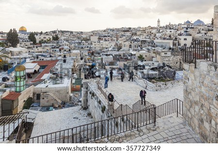JERUSALEM OLD TOWN, ISRAEL - NOVEMBER 1, 2014:  Unidentified tourists enjoying the view on the top of Damascus gate. - stock photo