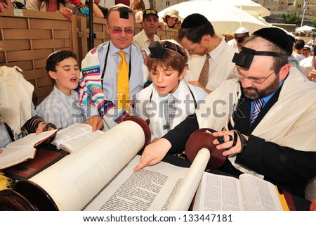JERUSALEM -SEP 22: Bar Mitzvah ritual at the Wailing wall on September 22 2008 in Jerusalem, Israel.Boy who has become a Bar Mitzvah is morally and ethically responsible for his decisions and actions. - stock photo