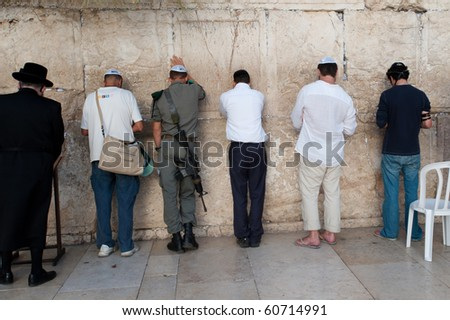 JERUSALEM - SEPTEMBER 7: Armed Israeli soldiers pray among other worshippers at the Western Wall in Jerusalem on September 7, 2010. Status of such sites is a major issue in peace negotiations.