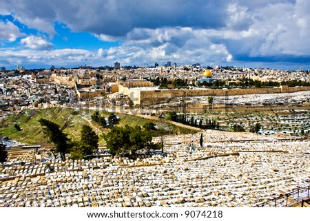 Jerusalem snow panorama (rare) view from Mt. Olives old cemetery - stock photo