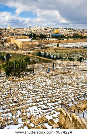Jerusalem under rare snow, wide view from old cemetery - stock photo