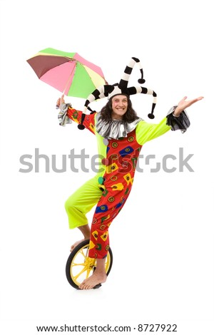jester joker riding one wheel bike on white background with a smile - stock photo