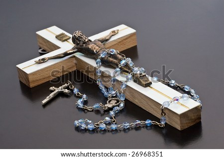 Jesus and rosary unlit background isolate. - stock photo