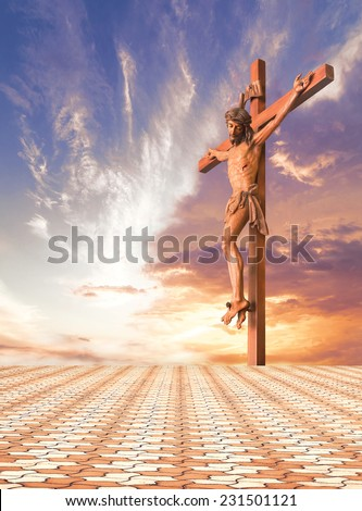 Jesus and the cross over sunset background with stone paving. - stock photo
