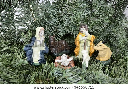 Jesus as a child with Mary and Joseph and animals  /  Holy Family - stock photo