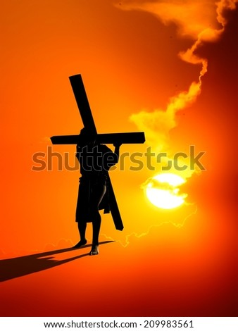 Jesus carries the cross on a red background. - stock photo
