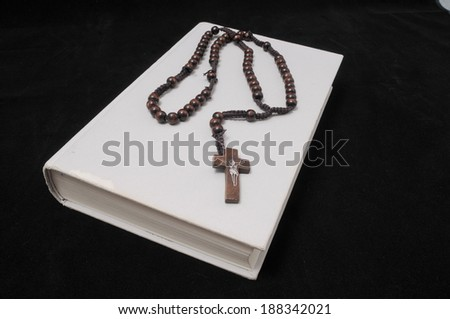 Jesus Christ and a Book on a Black Bacground - stock photo