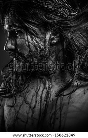Jesus Christ calvary, man bleeding, representation of passion with crown of thorns - stock photo