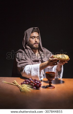 jesus christ consecrating the bread and wine - stock photo