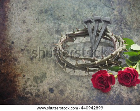 Jesus Christ crown of thorns, nails and two roses on a grunge background. - stock photo