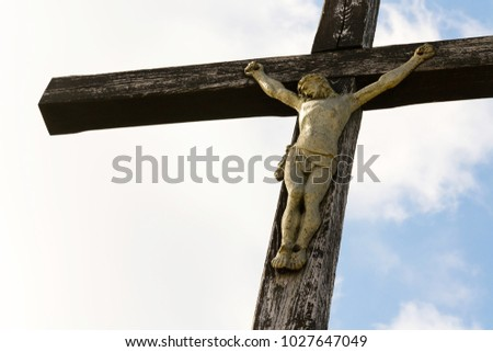 Jesus Christ crucifixion statue in front of the Jested tower, telecommunication transmitter on Jested Mountain near Liberec, Bohemia, Czech Republic
