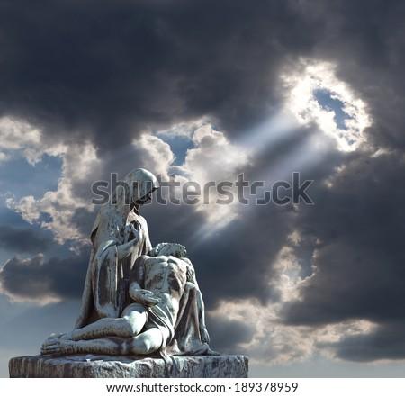 Jesus Christ - grave pieta scene with St. Mary. Religious art. - stock photo