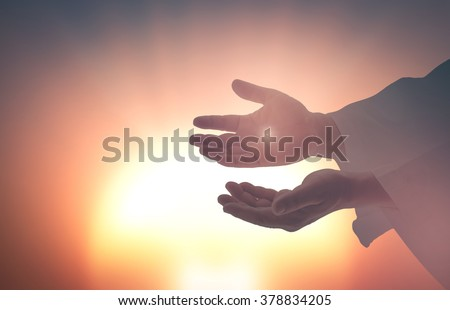 Jesus Christ hands showing scars. Resurrection Eucharist Bless Christian Nail Religion Week Semana Santa Saturday Lent He Is Risen God Life Because He Lives Early Grave Stone Cross Tomb Death concept - stock photo