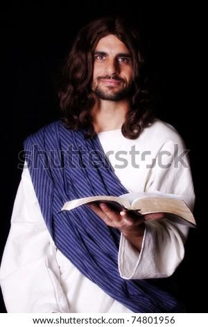 Jesus Christ holding the Bible - stock photo