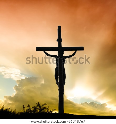 Jesus Christ on cross - stock photo