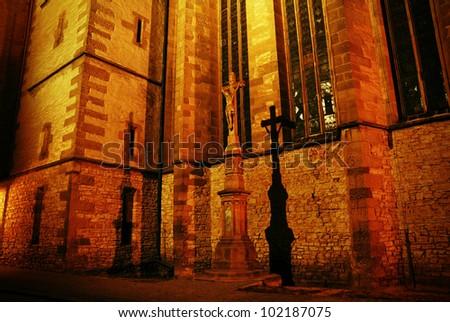 Jesus Christ on Cross in Night Church Scene - stock photo