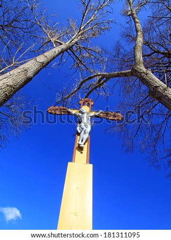Jesus Christ on the cross and blue sky - stock photo