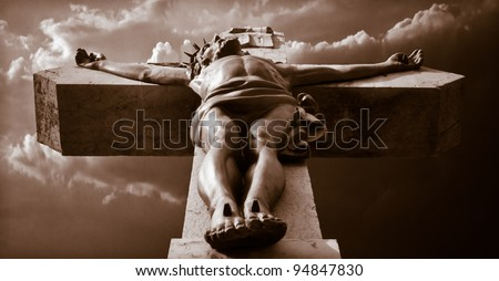 Jesus Christ on the cross in front of a dramatic background - stock photo