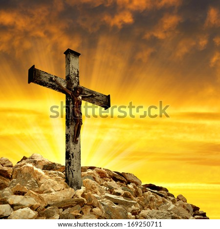 Jesus Christ on The Cross in the sunset - stock photo