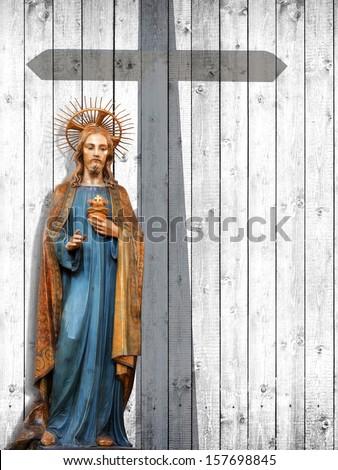 jesus christ, statue,cross, wood background - stock photo