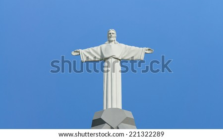 Jesus Christ - statue in the background of the cloudless sky - stock photo