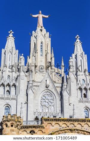 Jesus Christus Statue (by Josep Miret) at Expiatory Church of the Sacred Heart of Jesus (Temple Expiatori del Sagrat Cor) on summit of Mount Tibidabo in Barcelona, Catalonia, Spain. - stock photo