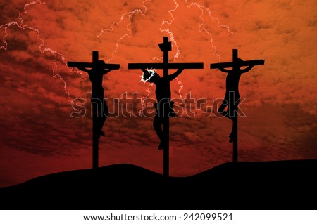 Jesus crucifixion.Silhouettes of the three crosses on a hill - stock photo
