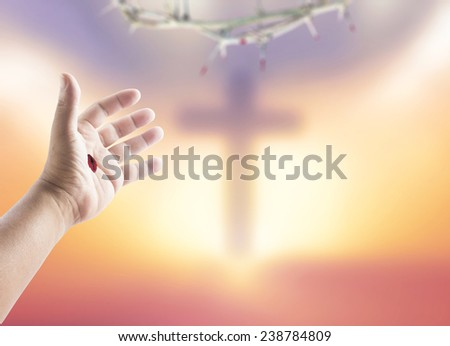 Jesus hand over blurred the cross on a sunset. Christmas background, Forgiveness, Mercy, Humble, Repentance, Reconcile, Adoration, Glorify, Redeemer, Redemption, Gospel, Love, Faith, Hope concept. - stock photo