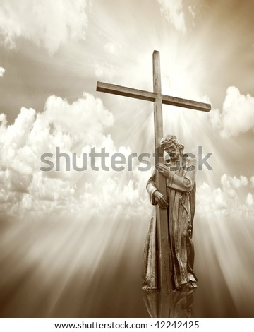 jesus holding a cross on cloud sepia background - stock photo