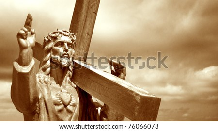 jesus holding cross on cloudy sky background - stock photo