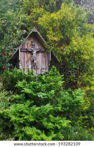 Jesus image in the middle of the leaves at Canela, Rio Grande do Sul - Brazil. - stock photo