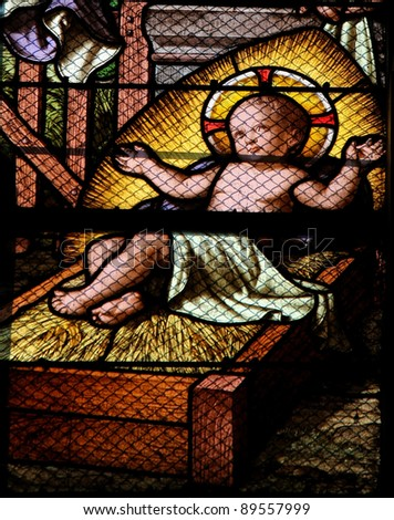 Jesus in the Manger: Nativity Scene stained glass window - stock photo