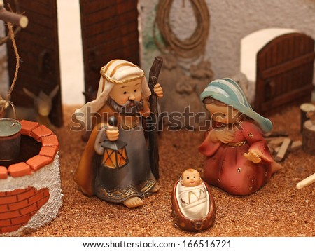 Jesus Joseph with the beard and the stick and Mary in a manger on Christmas and a well 2 - stock photo